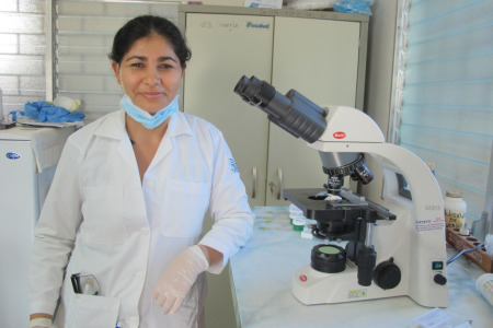 Telma, a former refugee, who has now trained as a lab technician with CAFOD funding, and working at the clinic