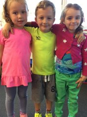 Three pupils wear bright clothes to fundraise for CAFOD