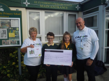 Students present cheque to CAFOD volunteers