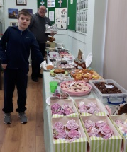 CAFOD Volunteer Mat and parishioner, Sam, set up the coffee morning at St Benet's, Netherton