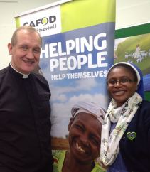 Fr Bruce from St Benet's, Netherton welcomes CAFOD partner, Sr Yvonne from Zambia