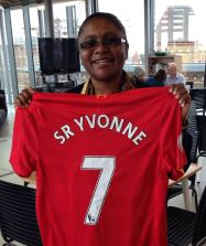 CAFOD Partner, Sr Yvonne is presented with a personalised Liverpool FC shirt from parishioners at St Benet's, Netherton