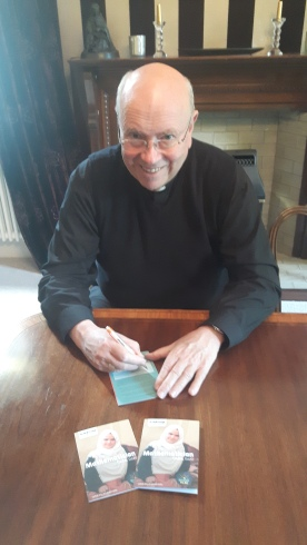 Archbishop Malcolm McMahon signed his card for the Power to be Campaign