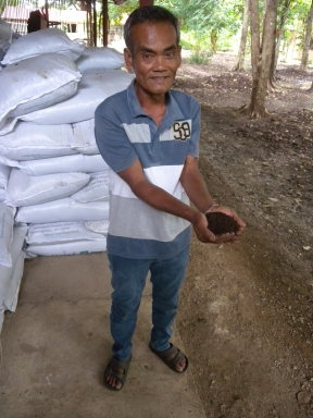 Tatay Ben with finished organic fertiliser b4